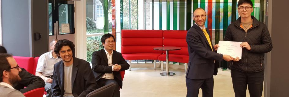Lev Sarkisov awards Bingsong Wang a Kenneth Denbigh Scholarship