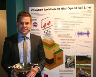 David Connolly with the Scottish Geotechnical Group poster presentation cup
