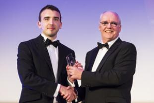 James Truesdale being presented his trophy by Keith Hall from AWE