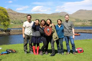 Researchers from the Institute for Materials and Processes dressed casually for outdoor spring activities with Loch Tay and Ben Laters behind them