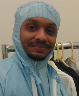 Mr Atif Syed, PhD student of the School of Engineering, in a laboratory clean suit