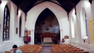 St Columba's Church Hall, with Dr Dimitri Mignard preparing helium balloons