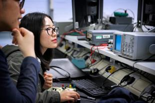 Engineering students in an Electrical and Electronics Engineering Laboratory