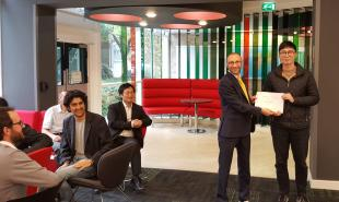 Lev Sarkisov awards Bingsong Wang a Kenneth Denbigh Scholarship