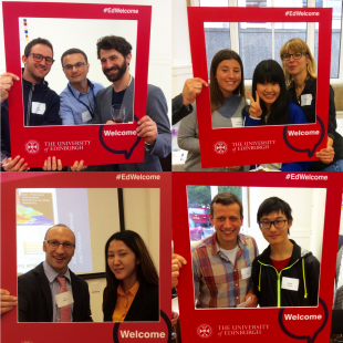 Academic staff and postgraduate students posing for pictures with University of Edinburgh #edwelcome red picture frame