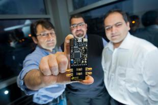 Professor Tughrul and co-founders of Sofant Technologies show off their latest research development