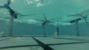 An underwater photo of tidal turbines within the Flowave Ocean Energy Research facility at the University of Edinburgh