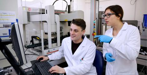 Postgraduate researchers in an engineering laboratory