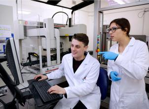 Postgraduate researchers in an engineering laboratory
